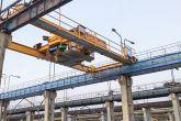 Speciální jeřáb 10t+10t s otočnou kočkou Adamec Crane Systems pro Prefa Praha